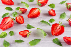 Colorful summer background of strawberry and mint leaf on white background. Stock Image