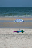 Colorful summer beach umbrella ideal for vacation Royalty Free Stock Photos
