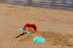Colorful Summer Children`s beach toys on a sandy beach by the sea Stock Photography