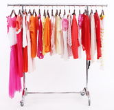 Colorful summer clothes. The multi-coloured women's summer clothes hangs on a hanger on white background stock image
