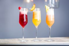 Colorful Summer Cocktails with Prosecco, Three Kind of Fruit Cocktails - Raspberry, Peach and Pineapple, Horizontal Wallpaper. Colorful Summer Cocktails with stock photography