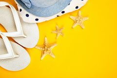 Colorful summer female fashion outfit. Beach, vacation, travel concept. Colorful summer female fashion outfit. Sunhat, white flip flops, polka dot towel, and stock photos