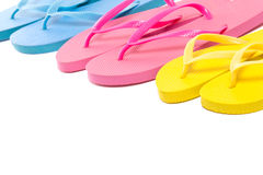 Colorful summer flip flop shoes over white. Background Royalty Free Stock Photos