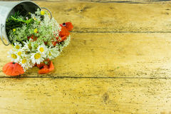 Colorful summer flowers. On a rustic wooden background Stock Images