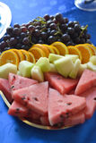 Colorful summer fruit platter watermelon, melon, orange slices and red grape Stock Image