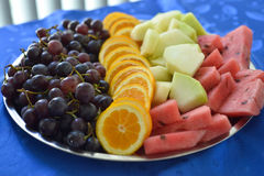 Colorful summer fruit platter watermelon, melon, orange slices and red grape. Picture of a  Colorful summer fruit platter watermelon, melon, orange slices and Royalty Free Stock Photos
