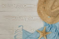 Colorful summer holiday beach banner background with accessories on white wood panel, border design on top view with copy space. Stock Images