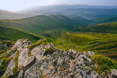 Colorful summer landscape in the Carpathian mountains. Stone surface. Mountain valley during sunrise / sunset. Natural summer landscape Royalty Free Stock Images