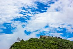 Colorful summer landscape in the mountains, under a blue sky with white clouds royalty free stock photo