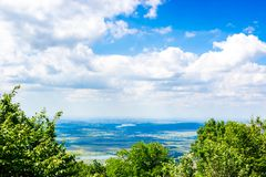 Colorful summer landscape in the mountains, under a blue sky with white clouds stock photos