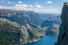 Colorful summer landscape in Norway mountains. Stunning view of the Preikestolen or Prekestolen Preacher`s Pulpit or Pulpit Rock above the Lysefjord, in Forsand Stock Photos