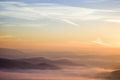 Colorful summer morning with golden light and fog Royalty Free Stock Photography