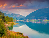 Colorful summer morning on the Resia lake Stock Images