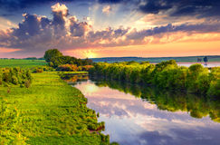 Colorful summer morning on river Stock Images