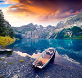 Colorful summer morning on unique lake - Oeschinen Oeschinensee Stock Photo