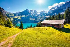 Colorful summer morning on the unique Oeschinensee Lake. Splendid outdoor scene in the Swiss Alps with Bluemlisalp mountain, Kande. Rsteg village location stock images