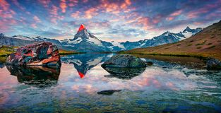 Colorful summer panorama of the Stellisee lake. Few minutes before sunrise. Great outdoor scene with Matterhorn Monte Cervino, Mont Cervin in Swiss Alps stock image