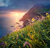 Colorful summer scene from Sunset Viewpoint in Gasadalur village. Dramatic evening landscape of Vagar island. Fantastic seascape o