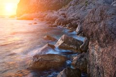Colorful sunny seascape. Colorful summer seascape. rocky coast at sunset Royalty Free Stock Image
