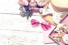 Colorful summer still life on wood table with place for text, sea shell royalty free stock photography
