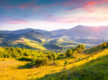 Colorful summer sunrise in the Carpathian mountains. With rolling hills and valleys in golden morning light.  Borzhava ridge, Transcarpathian, Ukraine, Europe Royalty Free Stock Image