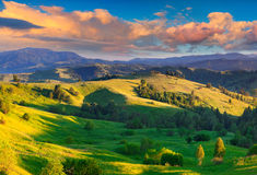 Colorful summer sunrise in the Carpathian village Royalty Free Stock Photos