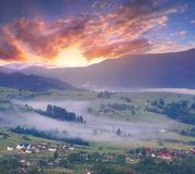 Colorful summer sunrise in the foggy mountains Stock Image