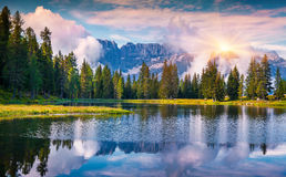 Colorful summer sunrise on the lake Antorno Royalty Free Stock Image