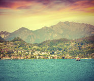 Colorful summer sunrise on the lake Como. City Dervio, Lombardy, Italy, Europa. Retro style Royalty Free Stock Photos