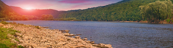 Colorful summer sunrise on mountain river Stock Image