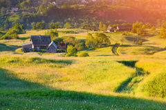 Colorful summer sunrise in mountain village Stock Photos