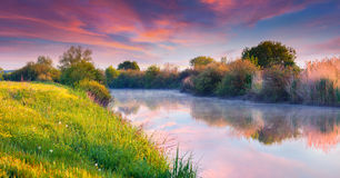 Colorful summer sunrise on river Stock Photography