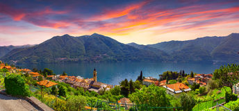 Colorful summer sunrise on the town of Carate Urio Royalty Free Stock Photos