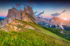 Colorful summer sunset on the Odle - Geisler group. National Par Stock Photos