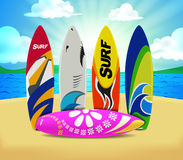 Colorful Summer Surfboards behind the Sunrise over the Wave Stock Photo