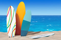 Colorful Summer Surfboards on the Sand Sunny Beach. 3d Rendering Stock Photos