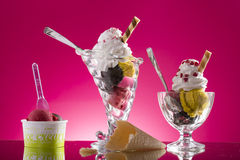 Colorful sundaes and takeaway plastic cup on pink background Stock Photos