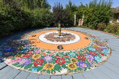 Colorful sundial hand-painted in a floral pattern, folk art, Zalipie, Poland. stock images