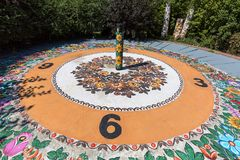 Colorful sundial hand-painted in a floral pattern, folk art, Zalipie, Poland. ZALIPIE, POLAND - AUGUST 3, 2018: Colorful sundial hand-painted in a floral pattern royalty free stock photos
