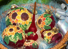 Colorful sunflower style painted Christmas balls set. Creatively painted christmas balls with shiny background royalty free illustration