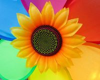 Colorful Sunflower Wind Spinner Decoration With Multi Color Background. Sunflower with beautiful design in center and a colorful background Stock Photos