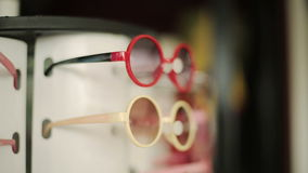 Colorful sunglasses for children on sale at the city market.  stock footage