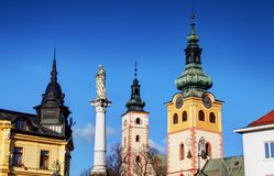 Colorful sunlit towers of main square Banska Bystrica Slovakia stock photos