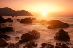 Colorful sunny seascape. Colorful summer seascape. rocky coast at sunset Royalty Free Stock Photo