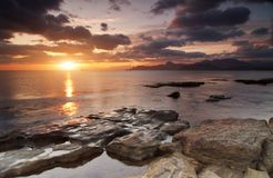 Colorful sunny seascape. Colorful summer seascape. rocky coast at sunset Stock Photos