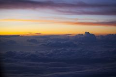 Colorful sunrise from the air. Sunrise over clouds - View from airplane Stock Photography