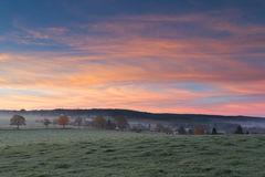 Colorful sunrise in the Belgium Ardennes. Royalty Free Stock Images
