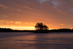 Colorful sunrise with clouds in the sky and frozen lake Stock Image