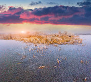 Colorful sunrise on the frozen lake. Royalty Free Stock Photo