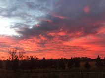 Colorful Sunrise. Massive display of colors as the sun rises over the horizon royalty free stock photo